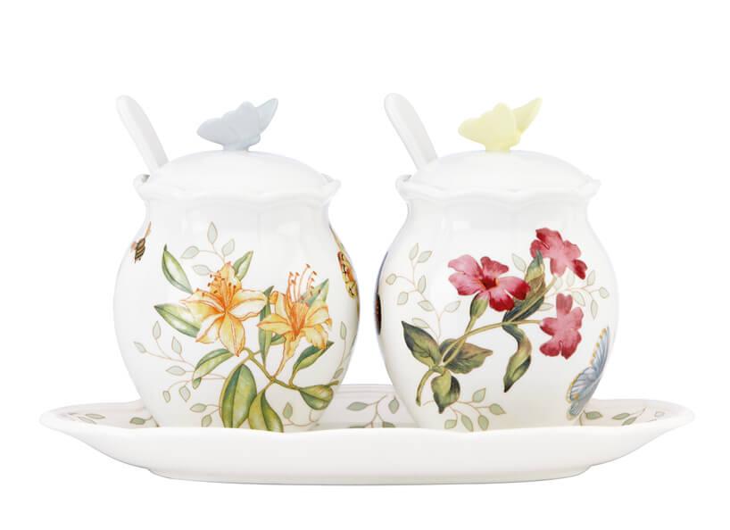 dwa ceramiczne pojeminiki złyżeczką zkwiatowymi wzorami