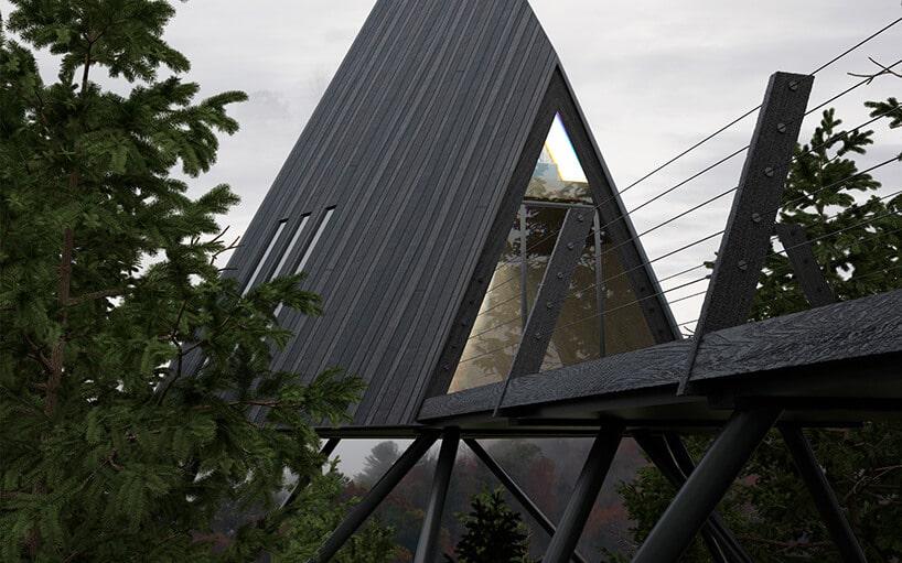 szary dom wkształcie trójkątnym ztrzema veluxami oraz szklanymi drzwiami