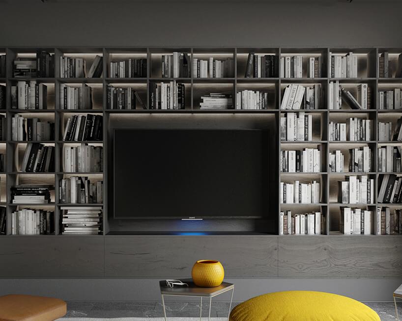 szary salon zdomową biblioteczką wokół telewizora