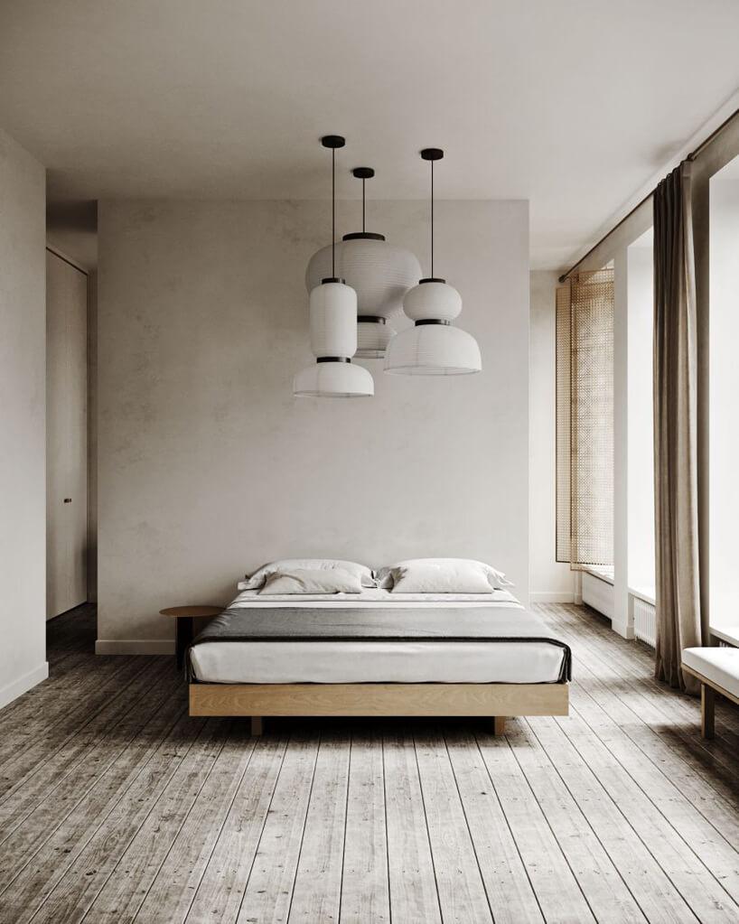 drewniane łóżko wszarej sypialni zdrewnianą podłogą ibiało-czarnymi lampami