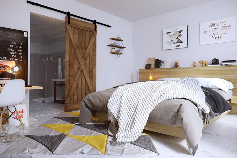 aranżacja sypialni zdużym łóżkiem oraz kolorowym dywanem