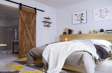 aranżacja sypialni z dużym łóżkiem oraz kolorowym dywanem