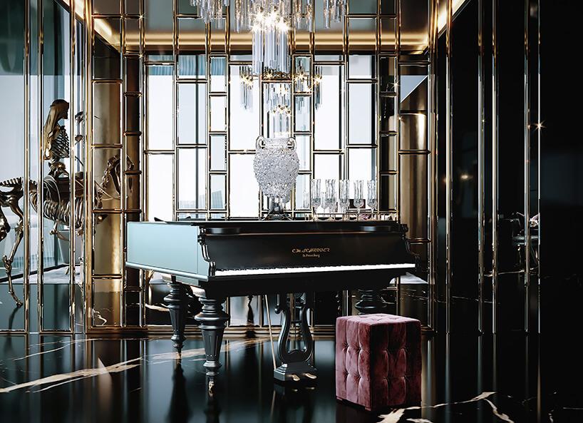 luksusowe wnętrze apartamentu wDubaju od Covet Houseczarno złote wnętrze pokoju zczarnym fortepianem iczerwoną pufą