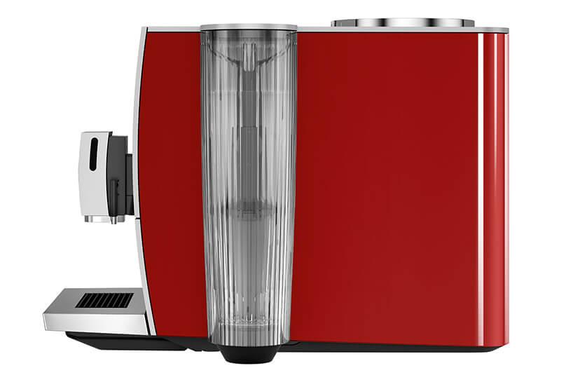 czerwony automatyczny ekspres do kawy odwrócony bokiem
