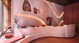 nowoczesne różowe wnętrze eleganckiego butiku KOPI projektu NOKE ARCHITECTS
