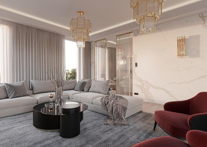 wnętrze eleganckiego apartamentu duża jasno szara narożna sofa przy czarnym niskim okrągłym stoliku