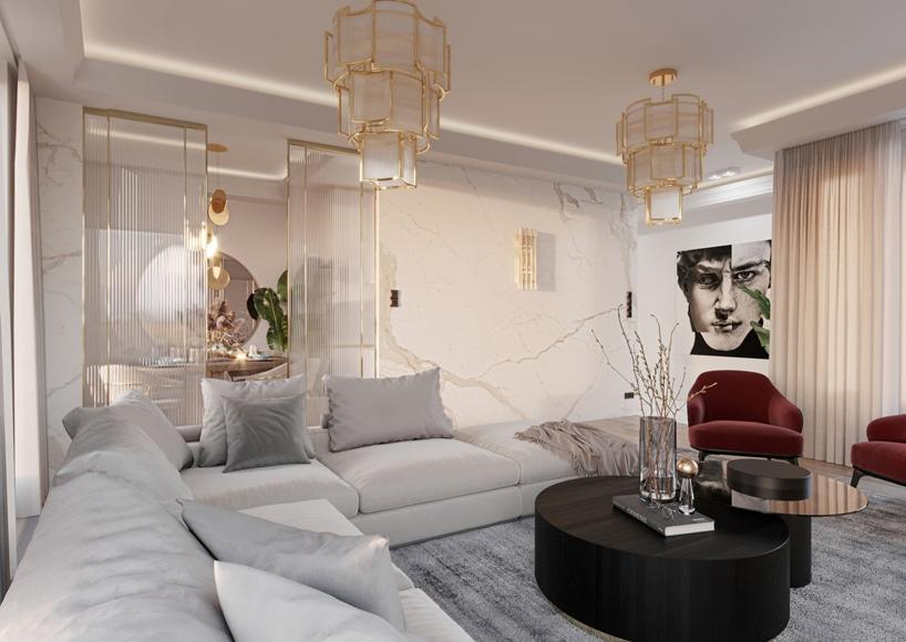 wnętrze eleganckiego apartamentu biały salon zkamieniem na ścianach