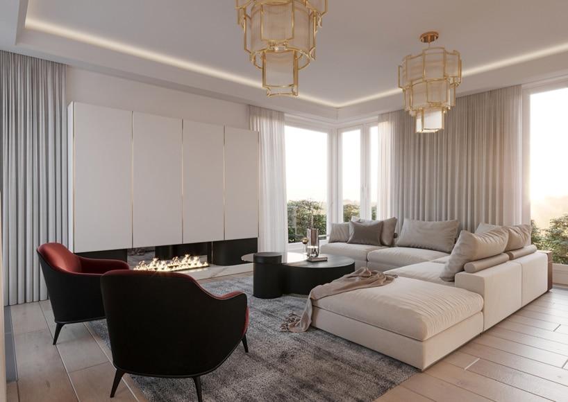 wnętrze eleganckiego apartamentu dwa złote żyrandole nad jasną narożną sofą