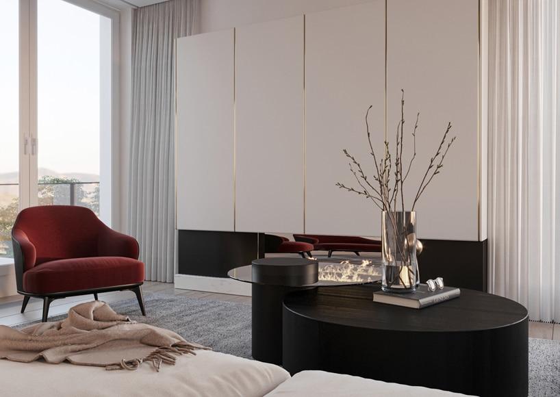 wnętrze eleganckiego apartamentu elegancki okrągły dwu poziomwy czarny stolik na tle białej zabudowy ze złotymi akcentami