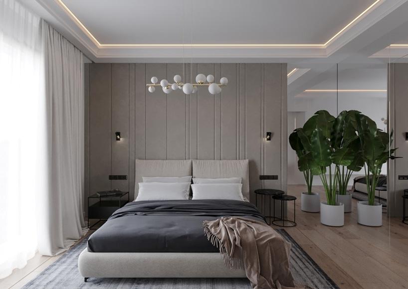 wnętrze eleganckiego apartamentu sypialnia zszarą ścianą