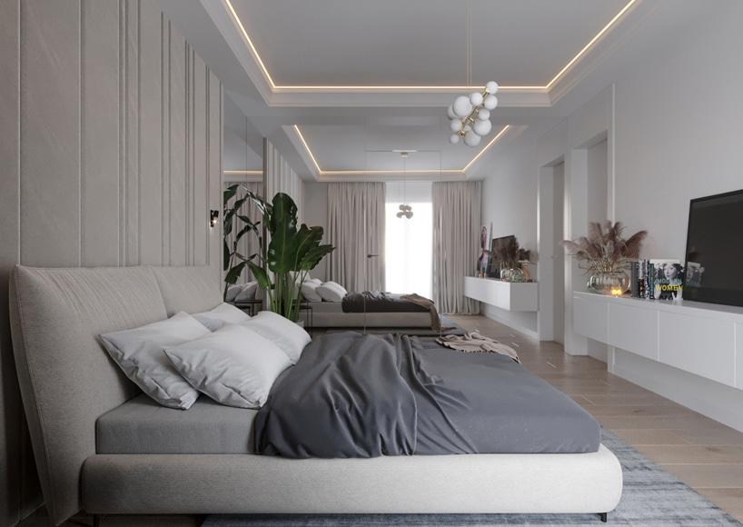 wnętrze eleganckiego apartamentu biała sypialnia zszarym łózkiem zbiałym podwieszanym sufitem