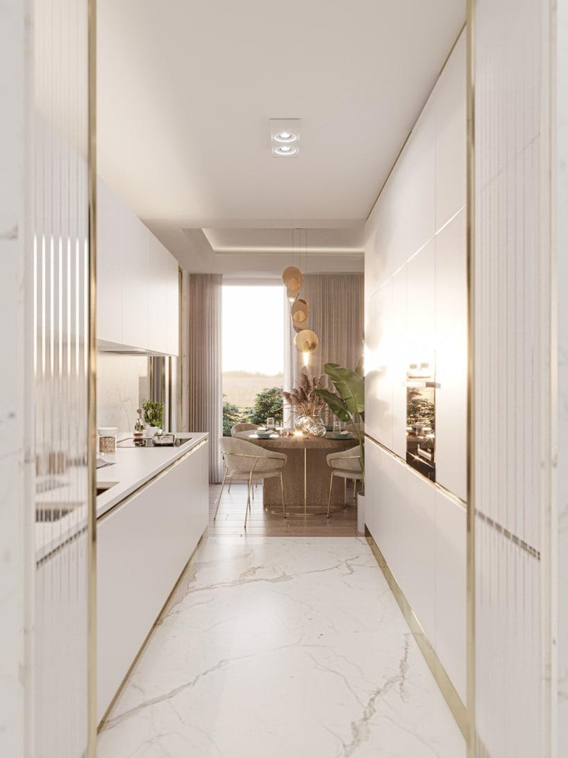 wnętrze eleganckiego apartamentu elegancka biała kuchnia ze złotymi akcentami ikamienną białą podłogą