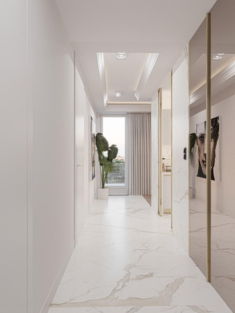 wnętrze eleganckiego apartamentu biały przedpokój zbiałą kamienną podłogą