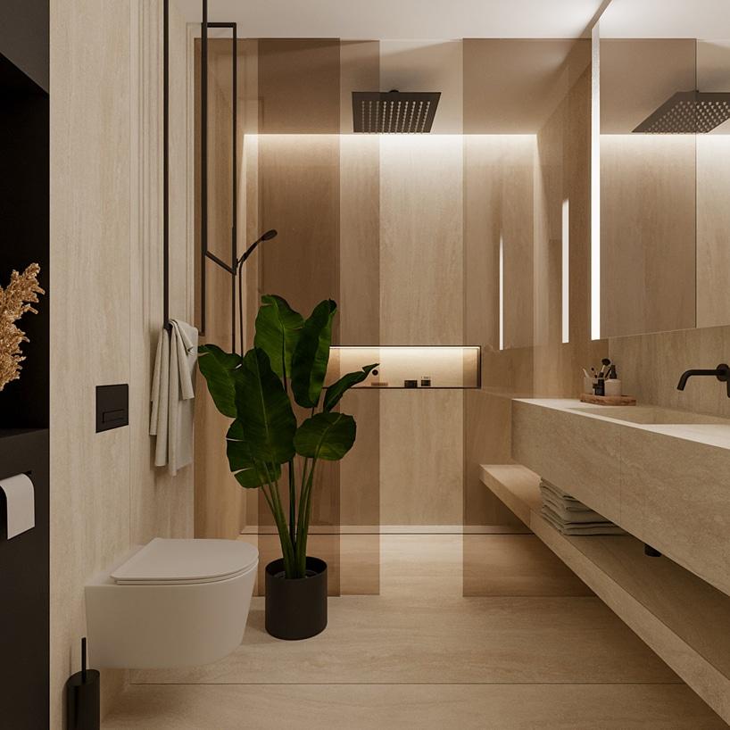 wnętrze eleganckiego apartamentu beżowa łazienka zprysznicem za dymioną szybą