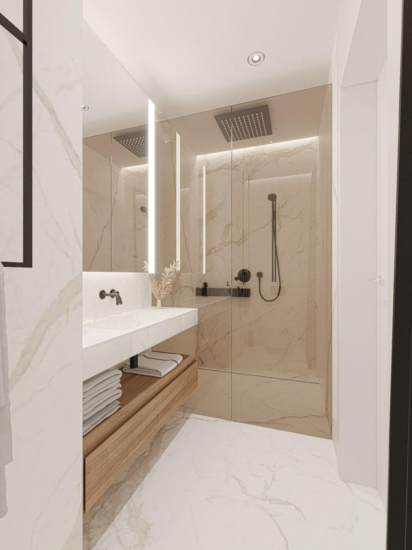 wnętrze eleganckiego apartamentu biała kamienna łazienka zdużym prysznicem za szybą