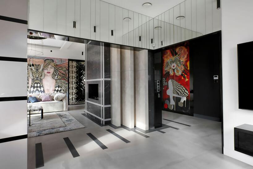 wnętrze apartamentu wykończonego czarnym białym iszarym kamieniem