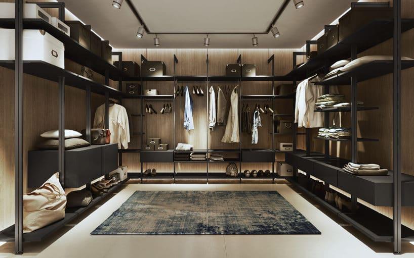 elegancka ciemna nowoczesna garderoba od Komandor zjasną podłogą iniebieskim dywanem po środku