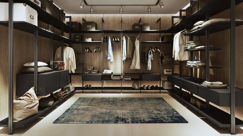 ciemna garderoba zciemnym systemem Orto od Komandora zniebieskim dywanem po środku