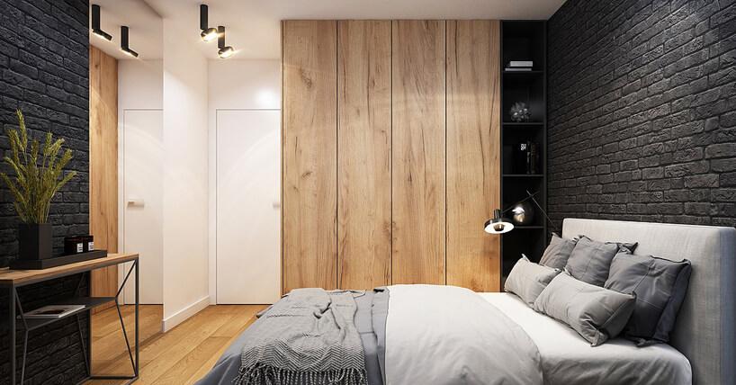 szafa wsypialni od Beforeconcept zdrewnianym frontem obok czarnych półek