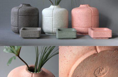 Trzy garnki gliniane szary biały i różowy gliniane miseczki szara zielona i różowa pomarańczowy garnek od góry i od dołu