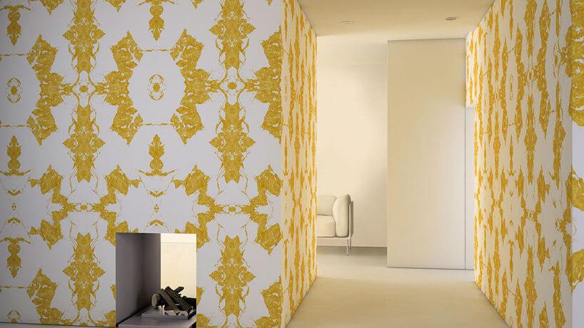 wnętrze salonu zzłotą wzorzystą grafiką ścienną Glamora