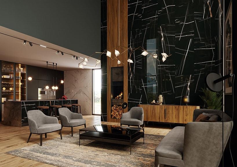 nowoczesne wysokie wnętrze zdodatkami drewnianymi oraz szarymi fotelami ilekko zieloną ścianą