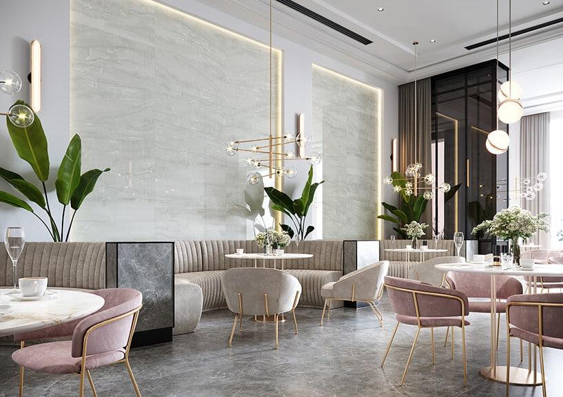 wnętrze restauracji zbeżowymi ipudrowo różowymi zaokrąglanymi kanapami