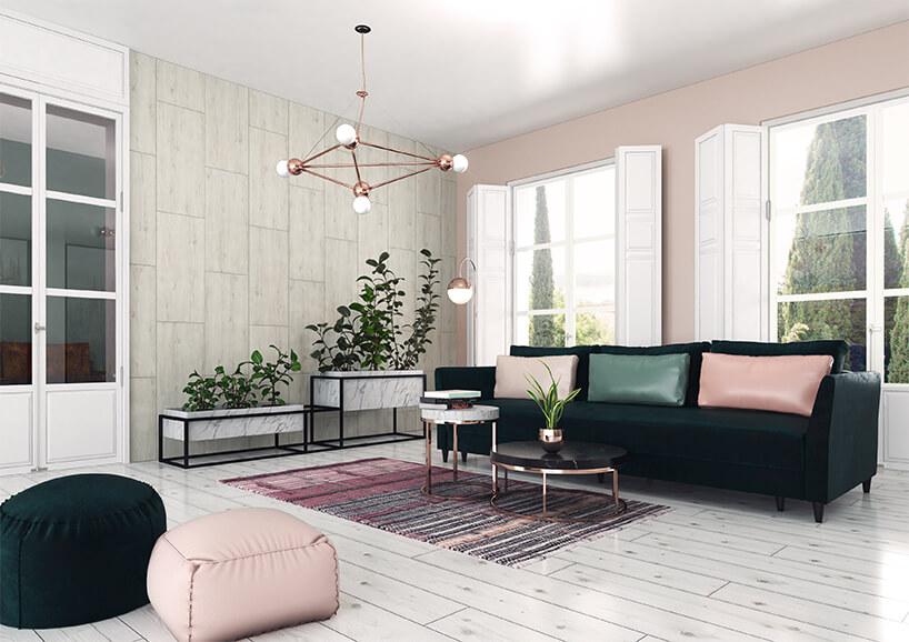 nowoczesne wnętrze salonu zbiałą podłogą dużą ciemną sofą stolikami iżyrandolem zmiedzianym wykończeniem