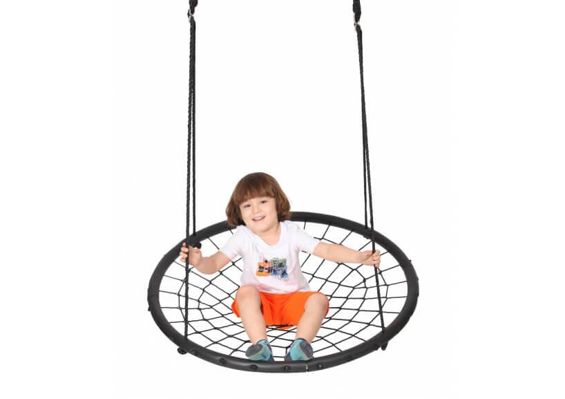 dziecko na huśtawce dla dzieci zsiatki