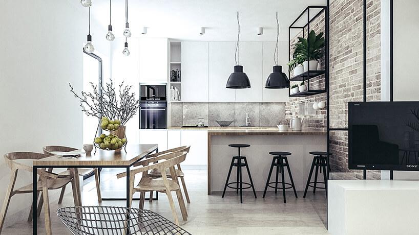 biała industrialna kuchnia zceglaną ścianą ibetonowym wykończeniem pomiędzy szafkami