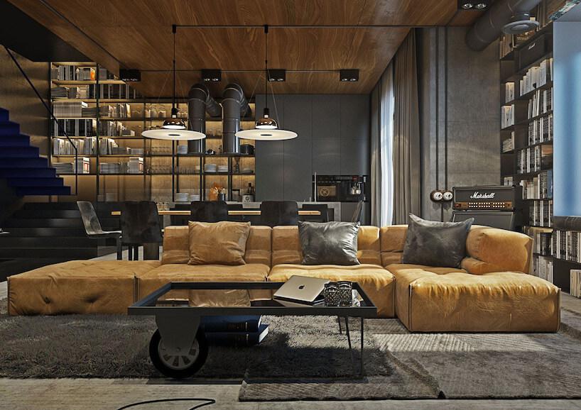 elegancki salon wstylu industrialnym zsufitem wykończonym drewnem zdużą żółtą sofą
