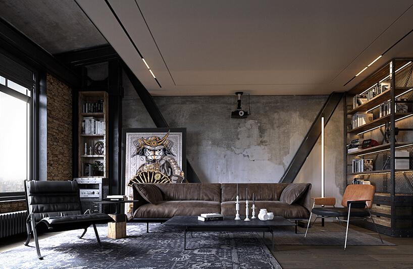 loft zbiałym podwieszanym sufitem zczarnymi filarami na tle betonowej ściany za długą brązową skórzaną sofą