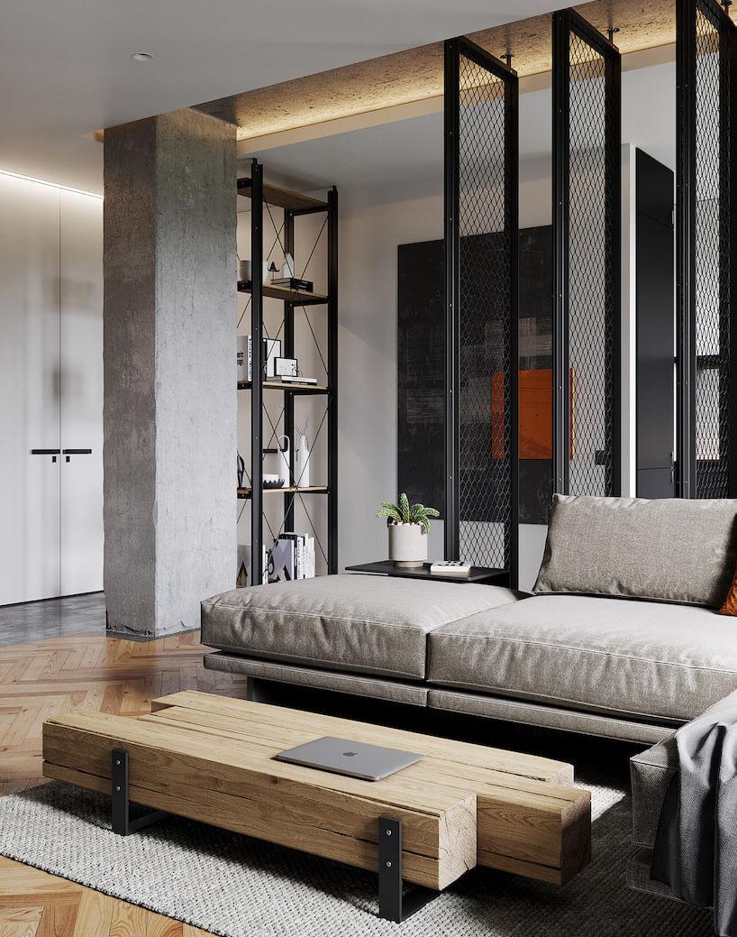 eleganckie wnętrze industrialne zbetonowym filarem metalowymi siatkami idrewnianą podłogą