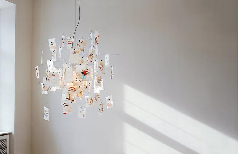 wyjątkowa praca Zettel'z od Ingo Maurer rożnej wielkości grafik rysunkowej twarzy wokół lampy