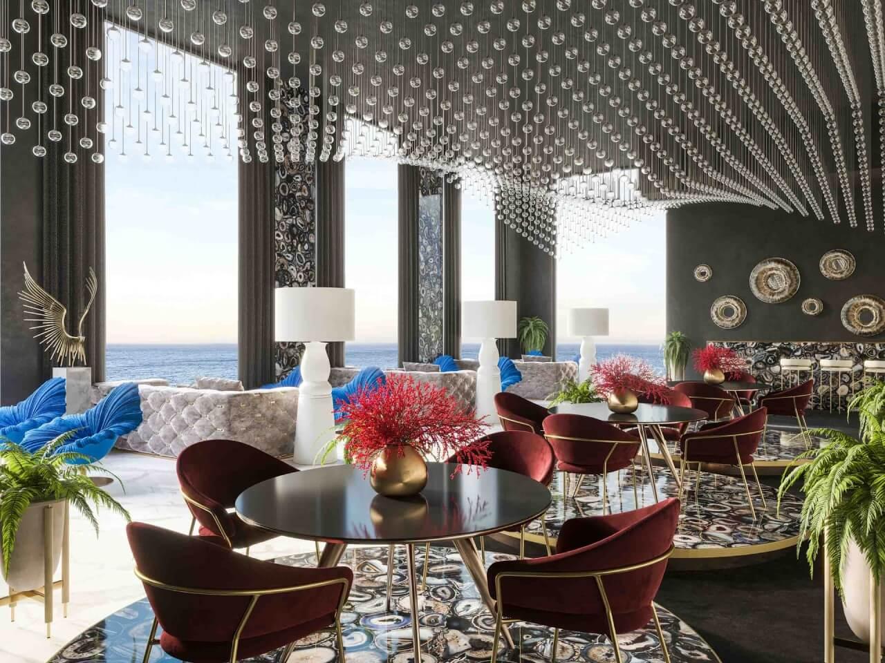 restauracja zkrzesłami wkolrze bordo ipodłogą zkamienia za dnia