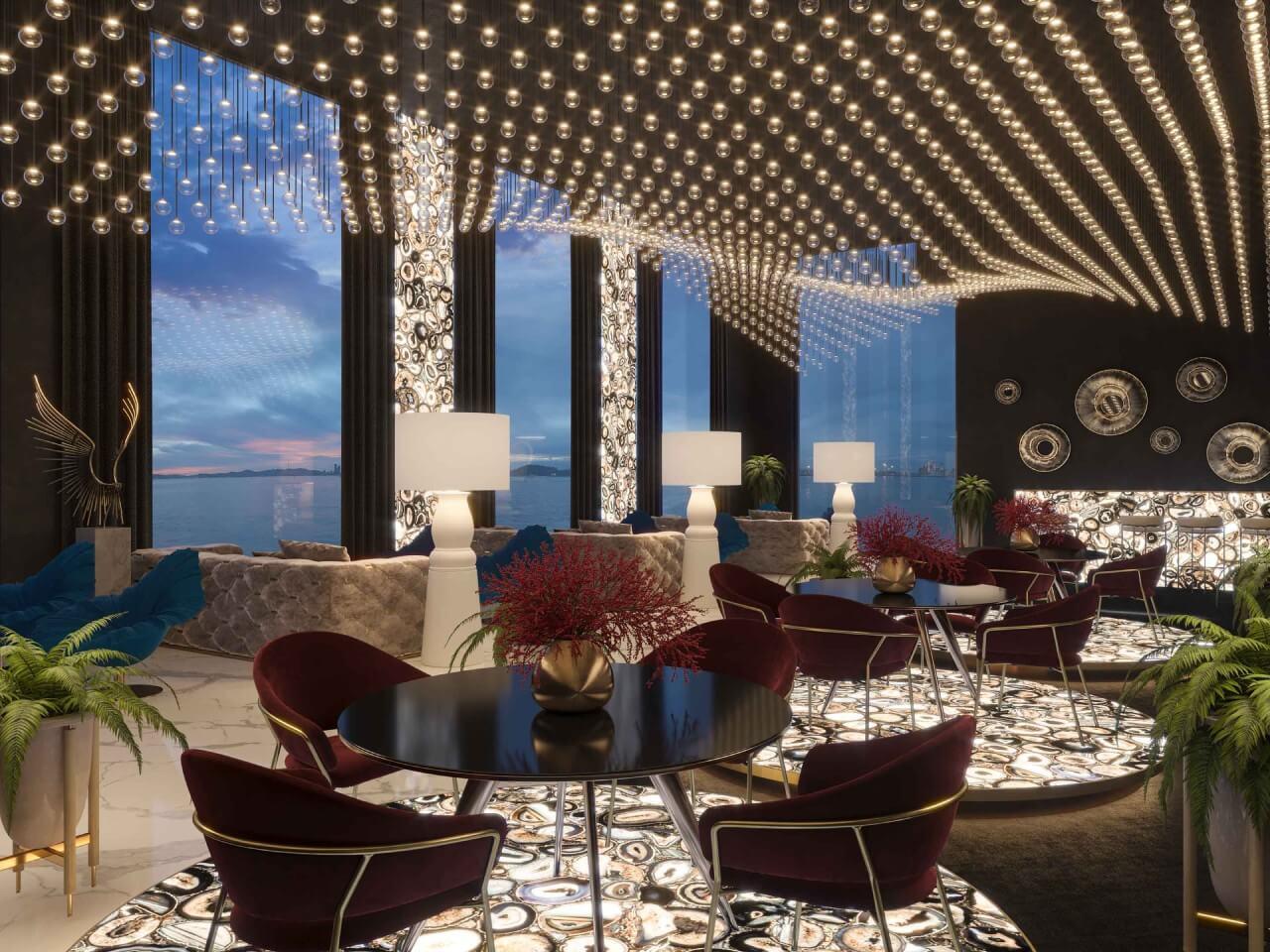 elegancka restauracja zbordowymi krzesłami iogłogą zkamienia - czarnego agatu