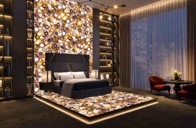 sypialnia z kamieniami od interstone na ścianie i podłodze