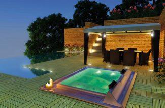 oświetlone jacuzzi na tarasie letniej rezydencji wieczorem