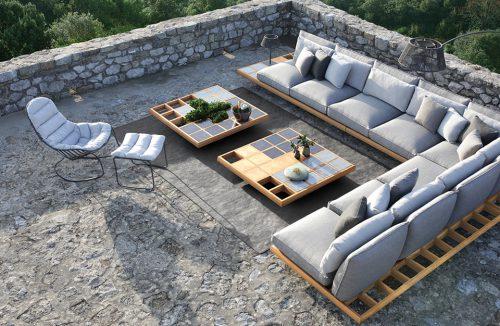 duży szary zestaw mebli ogrodowych Mozaix Lounge od Royal Botania na drewnianym stelażu z dużymi poduszkami na dużymi kamiennym tarasie