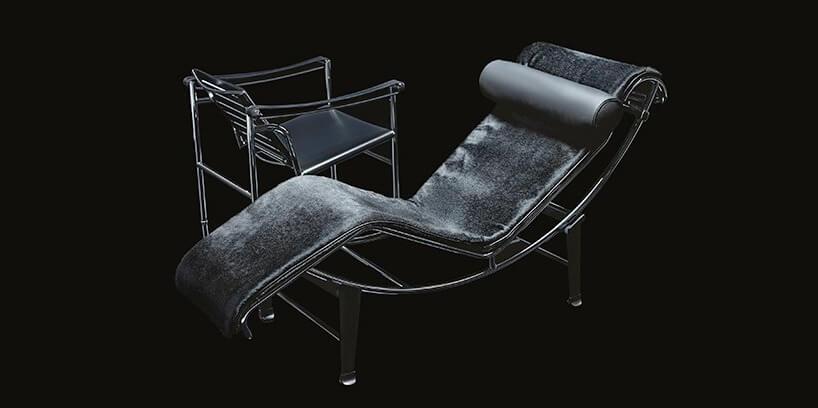 czarny fotel ikrzesło na czarnym tle