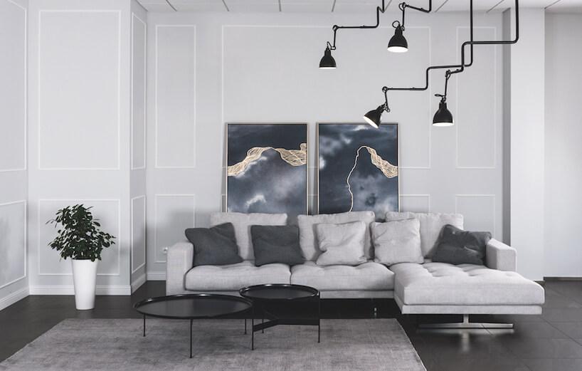 szara sofa na ciemnej podłodze za czarnymi owalnym stolikiem