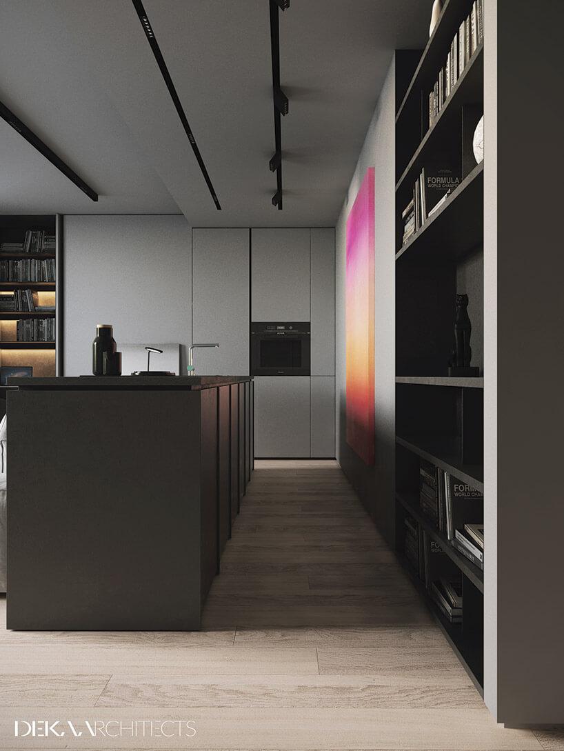 szaro-czarna kuchnia wydzielona oddzielona wyspą od salonu