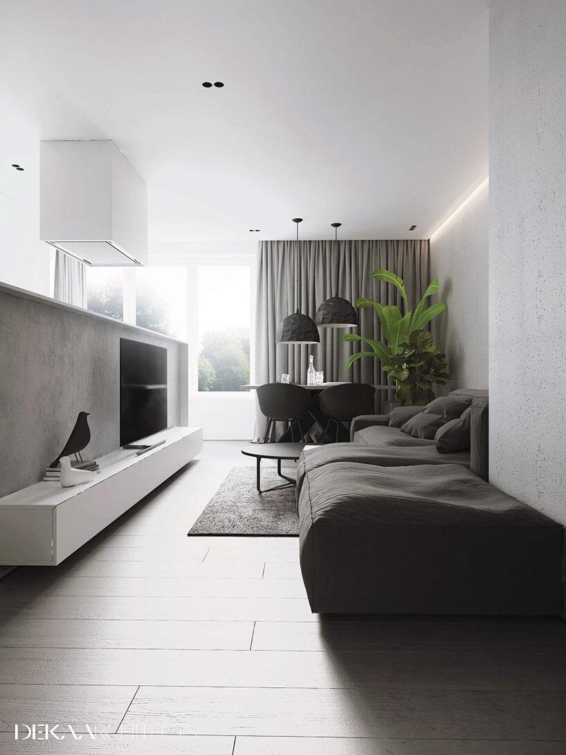 biały salon zdużym szarym siedziskiem bez oparć