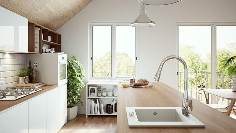 elegancka biała kuchnia zdużą wyspą zdrewnianym blatem małym biały zlewozmywakiem jednokomorowym