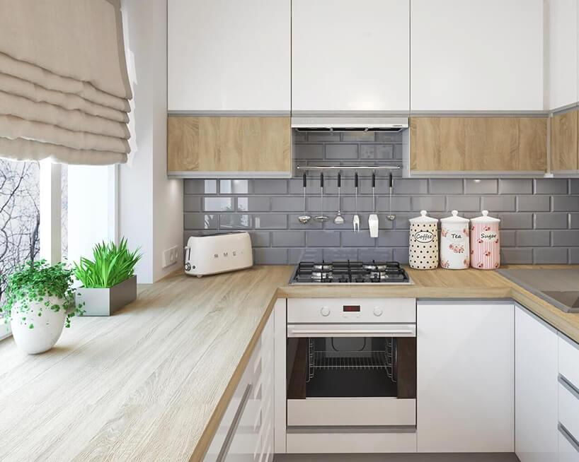szare płytki Tamoe Bianco wjasnej kuchni nad drewnianym blatem