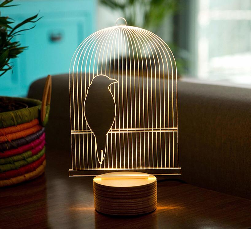 wyjątkowa lampka BIRD od STUDIO CHEHA podświetlony plastik wkształcie siedzącego ptaka wklatce