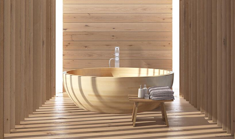 duża wanna COIBA zdrewna jesionowego od MICHOR pośród drewnianych ścian ipodłogi