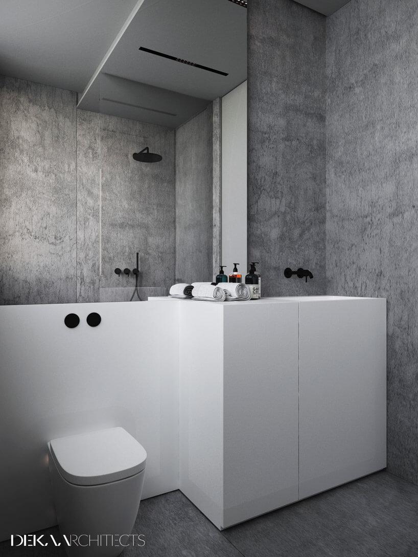 duża biała szafka na tle szarej ściany