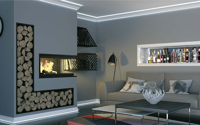 szare wnętrze salonu zbiałym sufitem ielementami dekoracyjnymi podświetlanymi przy podłodze isuficie