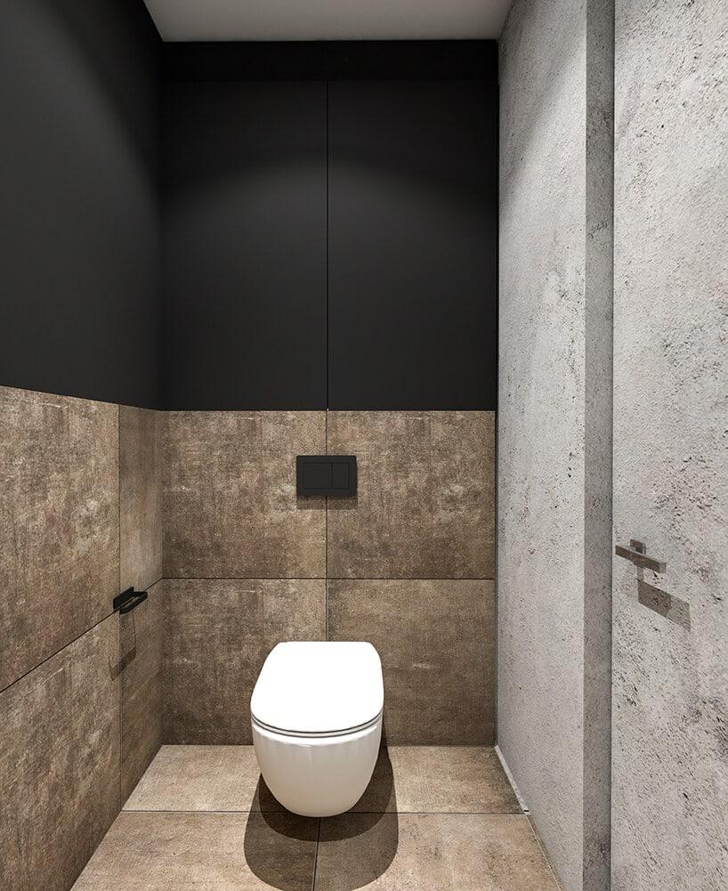 nowoczesna toaleta zwzorzystymi kafelkami wkolorach złota oraz czarnym konstrastem